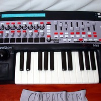 Novation Keyboard Mixer This cake was made to celebrate a friends graduation from Music Production school. This is a unit that is used to mix music and one he...