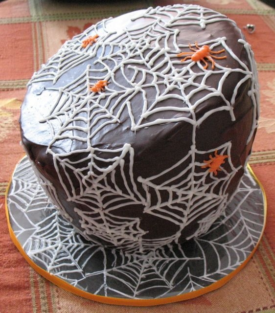 Spiderweb Cake Made for the Cake Walk booth at my son's school's Fall Carnival. Chocolate everything! Used the WBH Chocolate Glaze to coat, and...