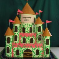 "Large Castle 12"" square, 8"" square and two 6"" rounds for the center tower. Turrets are fondant covered acetate rolls. All fondant (first..."