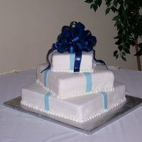 "Blue Bow Wedding Cake 16"", 12"", 8"" squares. The bride's colors were light blue and midnight blue. I think I would have gone with the same..."
