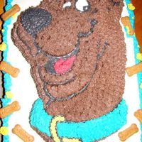 Scooby Dooby Triple Chocolate Fudge cake with buttercream icing and trimed in Honey Cracker Scooby treats....