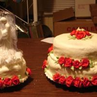 First Wedding Cake In 5 Yrs This is a butter pecan cake with cream cheese filing and crusting cream cheese icing. The roses are royal icing in which it has been almos6...