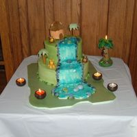 Jungle Cake This was a graduation, birthday, and going away cake. The girl was going off to Africa for two years, so we went with a jungle themed cake...