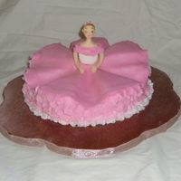 "Ballerina Cake  This is a 9"" yellow cake with almond BC. The doll is store bought fondant, and the dress is MMF. It is Debbie Brown's design from..."