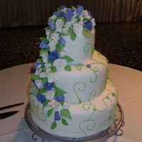 "Wedding Cake  This is my first official wedding cake order! :) It is 14"", 10"", & 6"". All chocolate, buttercream frostered and covered..."