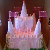 Castle Cake buttercream cake embossed with stone impression mat...with sugar cones iced in buttercream and rolled in sugar turret toppers