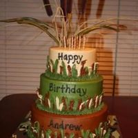 Camo Cake 3 teired chocolate cake with chocolate filling - I used a leave tip and grass tip for borders and used parts of an artificial cattail...