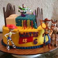 Toy Story Birthday Cake buttercream cake with figurines supplied by parents - bed made of cake covered with fondant embossed and accented with sprinkles. Head...