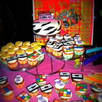 Totally Rad! Retro 80's Party zebra cake with boombox & aquanet bottle and cupcakes that had pacman, rubiks cube, cassettes, packman &...