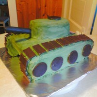 Tank Cake This is a tank that was made for 2 twin boys turning 11. WASC carved with buttercream and fondant accents.