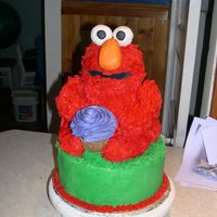 Elmo Birthday A cake I made for a coworkers son's birthday. Made with the wilton 3D bear pan. I thought that in the end it turned out looking like...