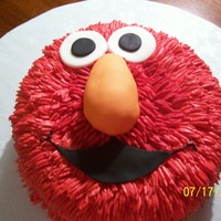 Elmo Birthday Cake   2 layer 8 inch round. Fondant covered RKT nose and fondant mouth and eyes