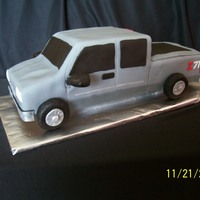 Silverado Extended Cab Pickup Cake  I did this for a 16 year old boy who got a gray extended cab Silverado pickup for his birthday. The cake was pound cake so I could carve it...