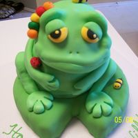 Froggy Birthday With Bugs I based this design on the cake from 50 Easy Party Cakes, but used a ball cake for the body. He is sitting on a chocolate cake lily pad....