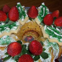 White Wreath   mango cake with strawberry cream cheese filling. cookie leaves and strawberries on top
