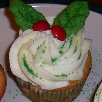 119809694893770.jpg   orange-cranberry cupcakes, lemon frosting, cookie holly leaves and red candy covered chocolates.