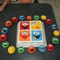 Sesame Street Cake was made to match invitation with Sesame Street cupcakes.