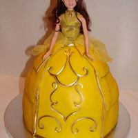 Princess Belle This was my first time working with fondant other than accent pieces. It was a bit frustrating but I'm happy with the outcome. Got my...