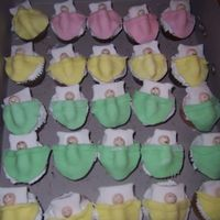 Baby Shower Cupcakes... These were something that I had been wanting to do for a while since seeing them in one of the Wilton yearbooks. They were fun to do. I...