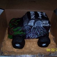Grave Digger After The Windows... were tinted with luster dust. I think it makes it look bunches better. Why do I always insist on not being happy with my cakes. I am my...