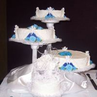 Wedding Cake These cakes are all white cake with buttercream icing. The triangles of blue icing were made by making a stencil with wax paper. The heart...