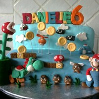 Mario I made this cake for my friends daughter who is mad about Mario, the cake is Choc & Vanilla sponge and the figurines are made from...