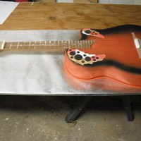 Guitar Grooms Cake On the way out with this cake my husband made me stop, in the garage no less, so he could get a photo. Lovely bakcground. UGH. but the...