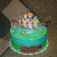 Fishing Cake for a grandfather and two grandsons. Gumpaste/fondant accents.
