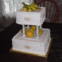 "Lemons   Bridal attendants wanted a ""Lemon"" themed cake...real lemons on the divider...gumpaste for the topper."