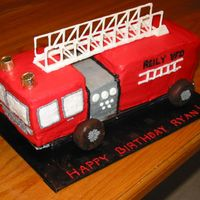 3D Firetruck This is a 3D firetruck that I made last night. I used a 1/4 sheet cake and cut the pieces I needed. Ladder is made rom royal icing and the...
