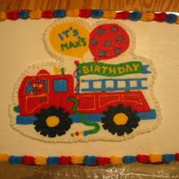 Firetruck Cake This is a firetruck cake I made to match the party invitations. The fireman bear went with the cake.