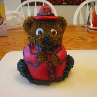 Fireman I made this fireman using the mini stand-up bear. The coat and hat are made from candy clay. The rest is buttercream.