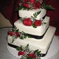 Robbie And Michelle's Wedding Cake My friends son's wedding cake, I did for them , real roses