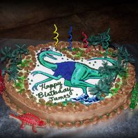 Edible Image Dino Chocolate oatmeal cake with chocolate buttercream icing. Last minute order asking for a dinosaur birthday theme for a 4-year-0ld boy. Found...