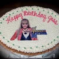 Hannah Montana Birthday Oval sheetcake with vanilla and chocolate buttercream. chocolate fudge cake. Edible image of H. Montana. Clear cake glitter sprinkled on...