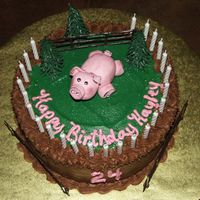 "Piggy Birthday Chocolate fudge cake, buttercream icing, fondant piggy, purchased fence and trees. Round 8"" layers."