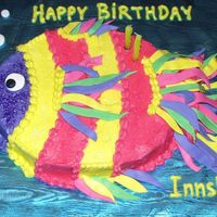 Fishy Birthday Brightly colored buttercream covered carved oval sheetcake. Fondant strips for fins, eyeball, and bubbles. Fresh banana cake with vanilla...