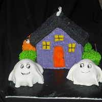 Haunted House wilton stand up house pan, mini doll pan for ghosts and monster in background. house is all bc, fondant covered ghosts. for 6 year old girl...