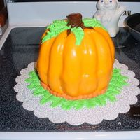 Fall Pumpkin A french vanilla cake with almond buttercream frosting and marshmallow fondant.