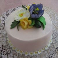 Monther's Day   Buttercream with fondant flowers.
