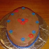 Just Because Cake Chocolate Butter Cream frosting, 2 layer oval cake. My very first try at making gum paste flowers. I love gum paste! Made this cake for...
