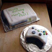 Xbox 360 Cake  This is my first attempt at a carved/3-D cake. We can't afford to buy a real Xbox, so I made my husband and his friend a cake instead...