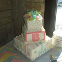 Corean_Shower_Cake.jpg Square 3 tier Baby Shower Cake. All buttercream with fondant accents.