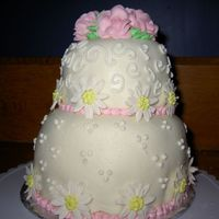 "Daisies And Roses A 6"" and a 4"" cake...my first time using MMF...I didn't do such a good job on it. I think it was too thick and heavy for the..."
