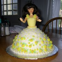First Doll Cake French vanilla cake with buttercream icing and yellow fondant bodice. My FIL asked me to make a cake for an auction. Maybe I'll drum...