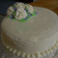 White Roses Vanilla cake with vanilla filling and BC icing roses and royal violets.
