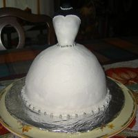 Emilys Bride Cake Vanilla cake with vanilla BC icing, fondant covered 'doll'. The Bride-to-be loved her cake as well as everyone at the shower.