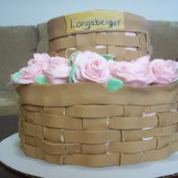 My Friend's Mother's Graduation Cake She sells longaberger. This is my second time working with fondant. Everything is fondant, basket weave, flowers, leaves...there is...