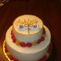 Red, Gold And White Graduation Cake   buttercream frosting with fondant rosetts painted with luster dust