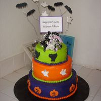 Halloween Birthday Cake  I made this cake for my cousins twins who had a Hallowwen themed birthday party. I got the design idea from the cake cenrtral gallery,...